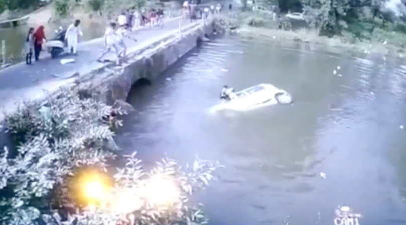 Family's Car Falls into River, Dad Tries to Throw Kids Up Onto Bridge, Misses Badly