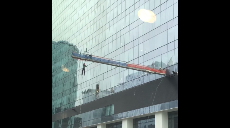 Window Washer Dangling for Dear Life in Crazy Video