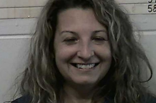 Woman Smiles for Mugshot After Stabbing Husband to Death