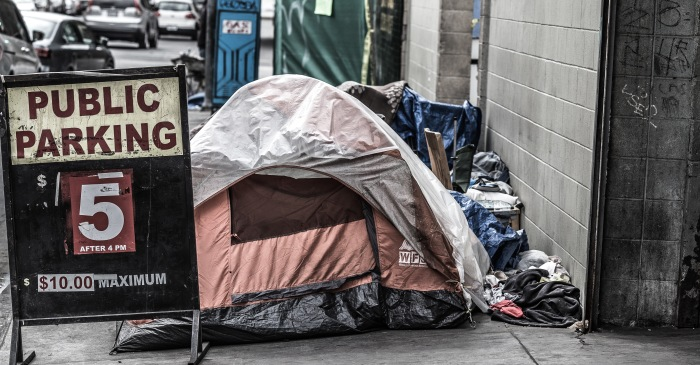 Strip Club Put Advertisements on Homeless People's Tents