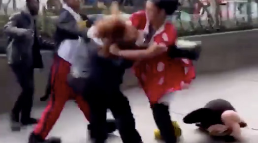 Minnie Mouse Street Performer Brutally Beats Down Security Guard in Fight Video