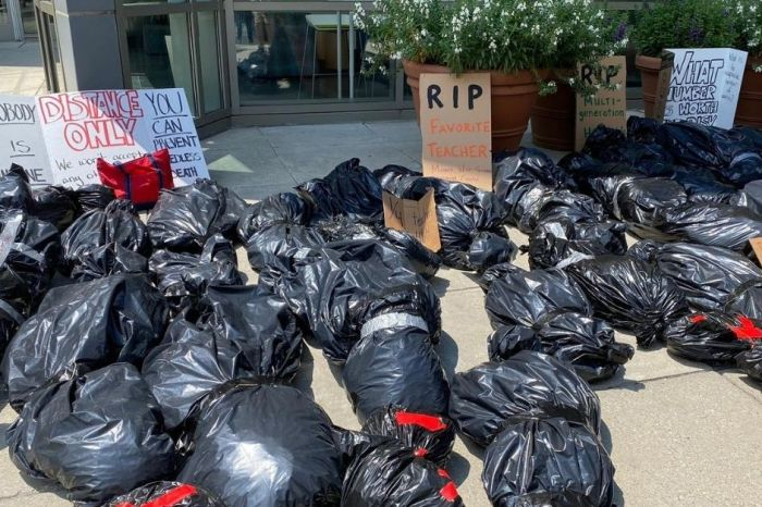 Teachers are Lining Up 'Body Bags' Outside School Offices to Protest Return to In-Person Classes