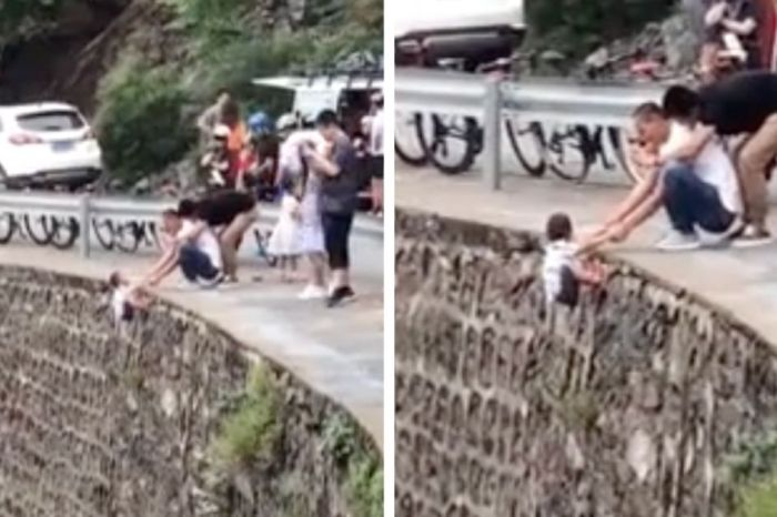 Dad Nonchalantly Hangs Son Off Huge Cliff to Take a Photo