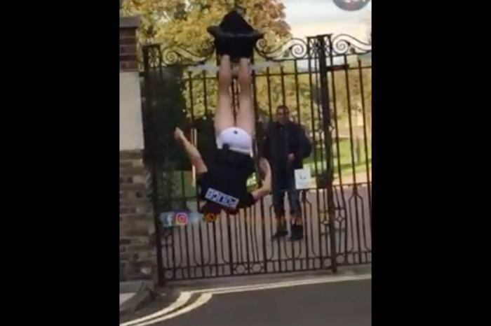 Cop Filmed Stuck On Fence, Upside Down, Without Pants