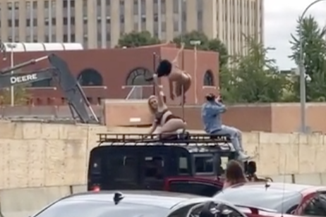 Strippers Seen Dancing on Top of Moving Humvee Equipped with Pole